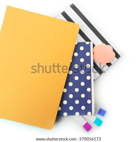 A pile of stylish notebooks, isolated on white background - stock photo