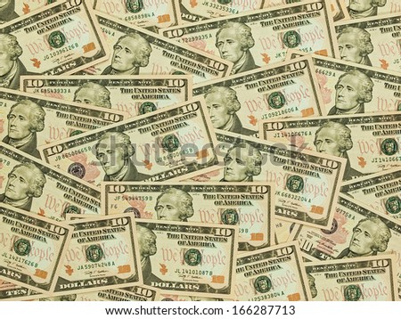 A Pile of Ten Dollar Bills as a Money Background - stock photo
