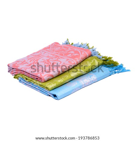 A pile of traditional Turkish scarves isolated on white background - stock photo
