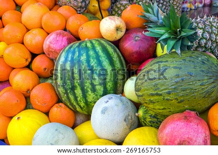 A pile of tropical fruits seen at a market - stock photo