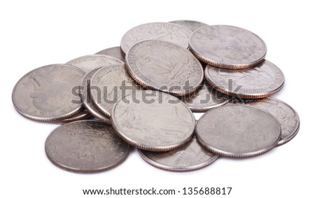 A pile of 25 US cent (quarter) coins isolated on white background. - stock photo