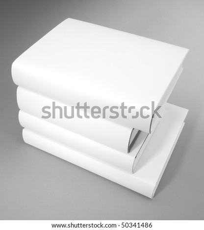 A pile of various size of hardcover books - stock photo