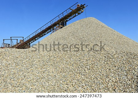 A pile of washed river gravel - stock photo