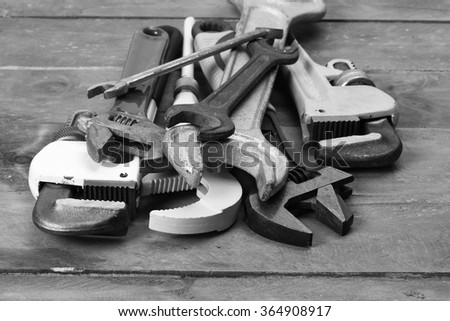 a pile of wrenches close up, black and white picture - stock photo