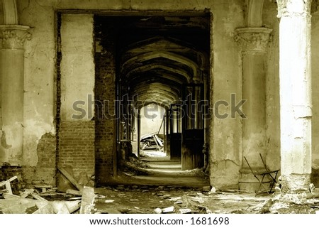 A pillared hallway with open doors in an old, forgotten castle ruin in Europe, - stock photo
