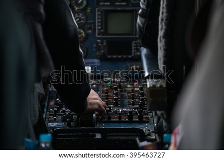 A Pilot hand is controlling plane to fly take off and landing - stock photo