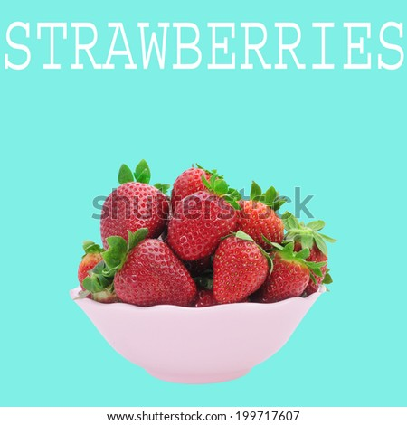 a pink bowl with appetizing strawberries and the word strawberries on a blue background - stock photo