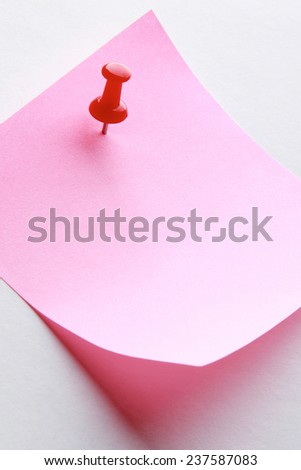 A pink memo note with a red pin, isolated on white - stock photo