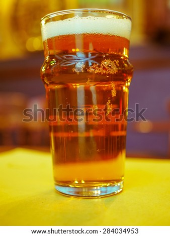 A pint of British ale beer alcoholic drink in a pub - stock photo