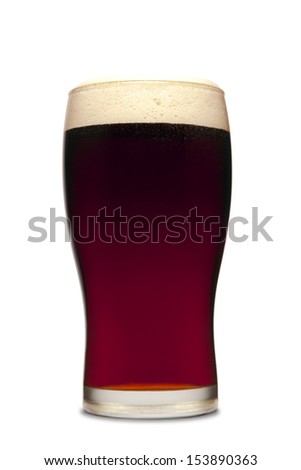 A pint of dark beer isolated on white. - stock photo