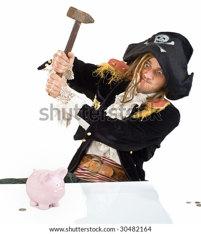 a pirate aiming a hammer at  a piggy bank isolated on white - stock photo
