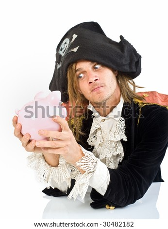 a pirate holding a piggy bank isolated on white - stock photo