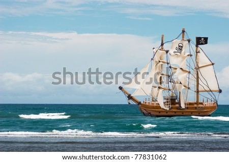 A pirate ship with black flag in the ocean, Pirate Ship - stock photo