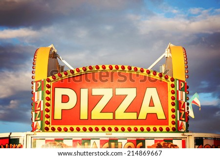 a pizza sign at the state fair on a hot sunny day right before dusk  - stock photo