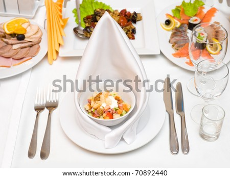 a place setting at laid restaurant banquet table - stock photo