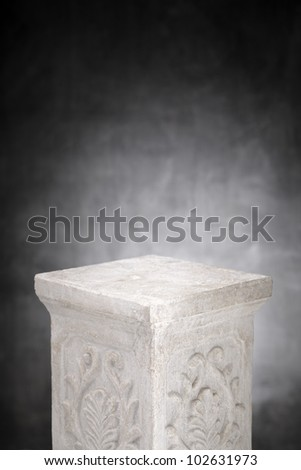 A Plaster column with nothing on its top. - stock photo