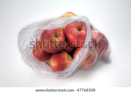 A Plastic Bag of Gala Apples Isolated on White - stock photo