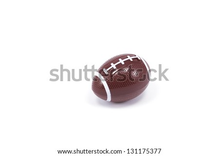 A plastic football sits amongst a white background with plenty of room for copy - stock photo
