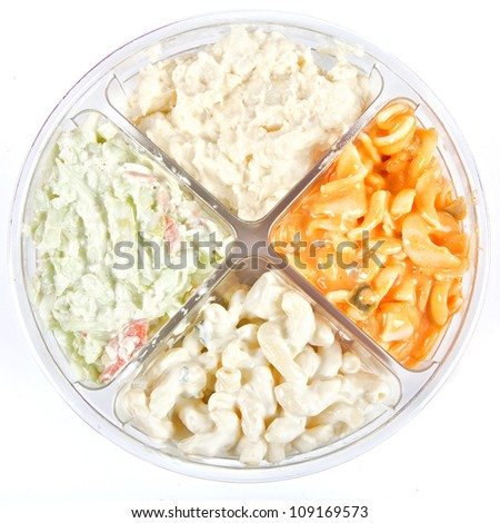 A plastic store bought divided container with 4 different prepared salads, macaroni salad, coleslaw, tomato pasta salad and potato salad. - stock photo