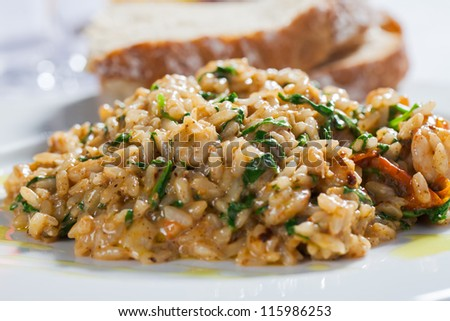 A plate filled with rice and vegetables - stock photo