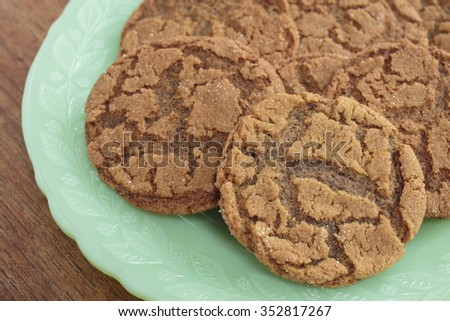 A plate full of home made ginger snap cookies. - stock photo