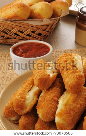 a plate of deep fried breaded mozzarella cheese sticks - stock photo