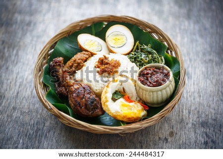 A Plate of Delicious Ayam Penyet with Sambal Belacan(Homemade Chili Sauce) and Tempe - stock photo