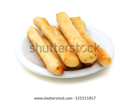 a plate of garlic bread sticks on white background - stock photo