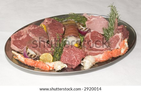 A plate of meat and seafood - stock photo