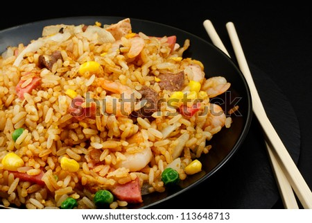A plate of oriental food Special fried rice - stock photo