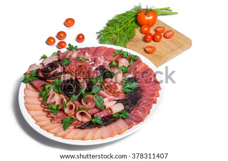 A plate of sausages with tomato and parsley - stock photo