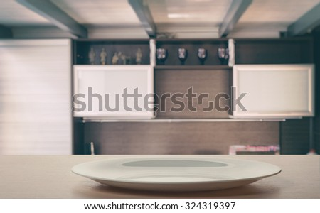 A plate on the kitchen table - stock photo