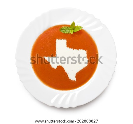 A plate tomato soup with cream in the shape of Texas.(series) - stock photo