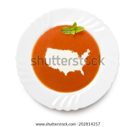 A plate tomato soup with cream in the shape of USA.(series) - stock photo