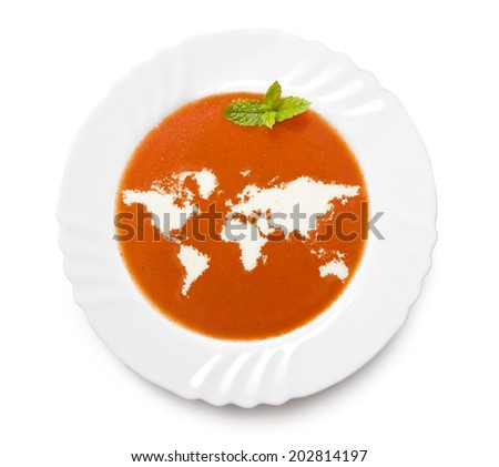 A plate tomato soup with cream in the shape of World.(series) - stock photo