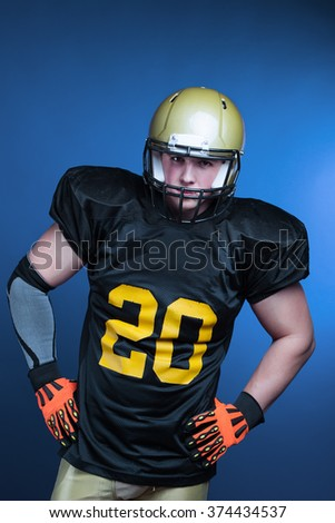 A player in american football with helmet on the head. - stock photo