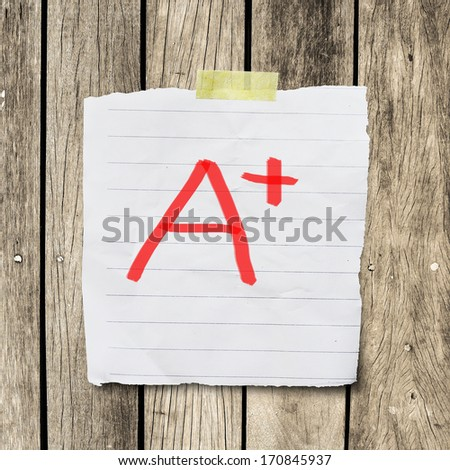 A plus grade on message paper with clipping path - stock photo
