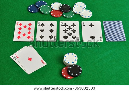 A poker table with cards and chips - stock photo