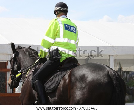 A Police Constable on Duty on a Police Horse. - stock photo