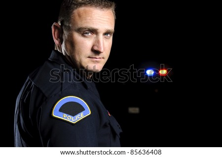 a police officer in the night. - stock photo