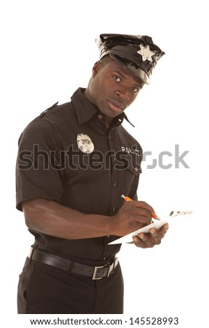 A policeman writing a ticket with a serious expression. - stock photo