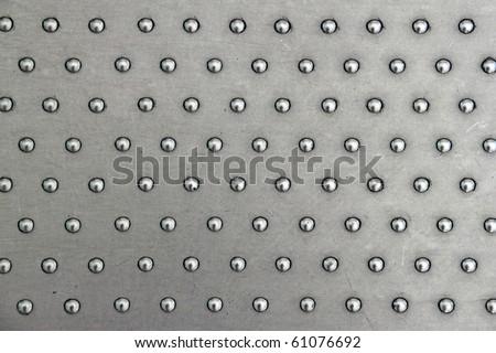 A polished matt aluminum stud plate. - stock photo