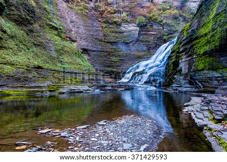 A pool in one of the greatest gorges in the Ithaca area holds numerous small trout - stock photo