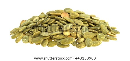 A portion of organic dry roasted pumpkin seeds isolated on a white background. - stock photo