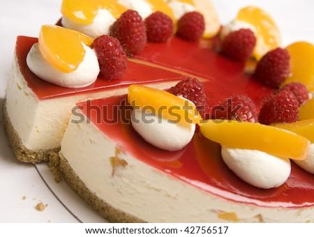 A portion of Raspberry & Mandarin cheesecake - stock photo
