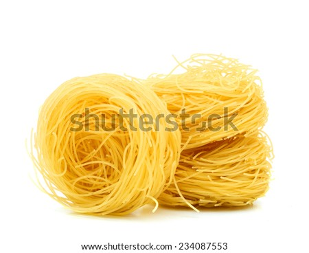 A portion of tagliatelle pasta isolated on white  - stock photo