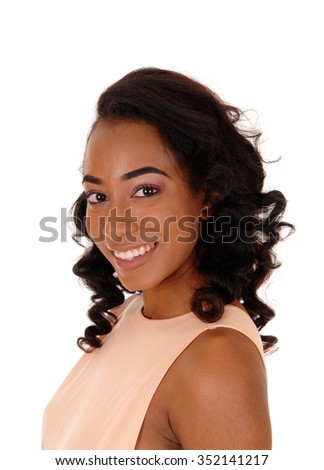 A portrait image of a African American women in a beige dress, smiling,isolated for white background. - stock photo