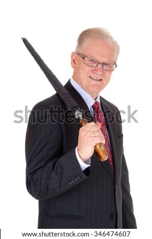 A portrait image of a senior man in a dark suit with a black umbrellaover his shoulder, isolated for white background. - stock photo