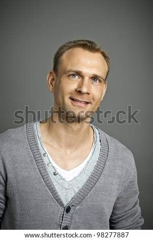A portrait image of an attractive male with blue eyes - stock photo