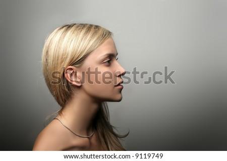 A portrait of a beautiful girl. Profile - stock photo